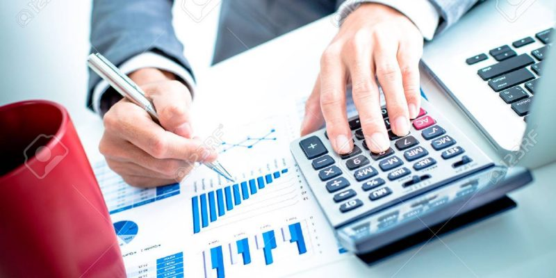 36429824-businessman-analyzing-investment-charts-with-laptop-accounting