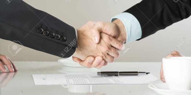 20208494-businessmen-are-signing-a-contract-business-contract-details