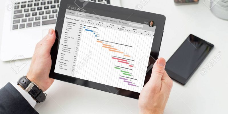 71930363-businessman-looking-at-gantt-chart-on-tablet-computer